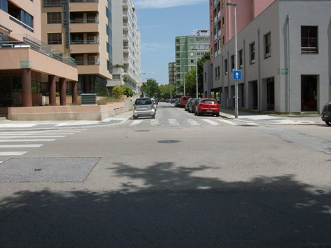 Photography of lowered pedestrian crossings with tactile pavement at an intersection in Professor Bento Jesus Caraça Street