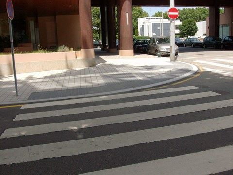 Photography of a lowered pedestrian crossings with tactile pavement at an intersection in Professor Bento Jesus Caraça Street